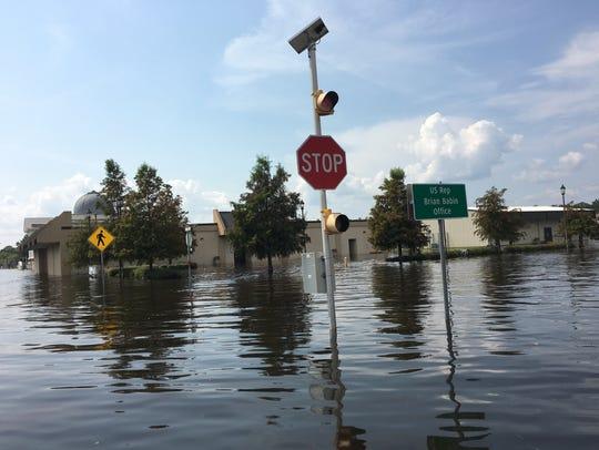 Swaths of Orange, Texas, remained underwater Sunday,