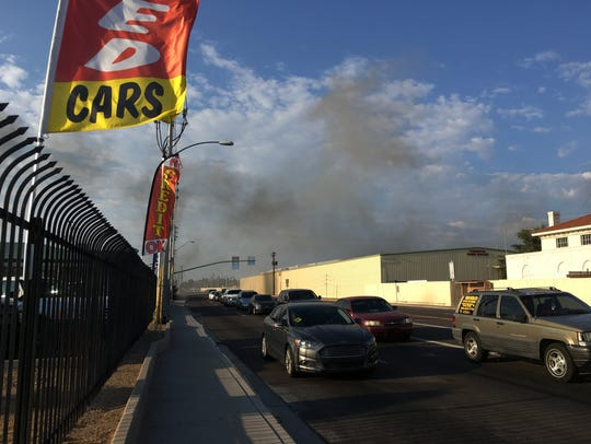 Smoke drifted onto 19th Ave. as firefighters worked