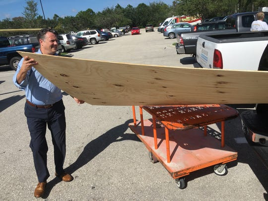 David Lang of Fort Myers loads wood into his vehicle