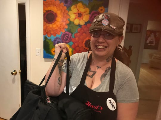 Hart's Local Grocers' Andrea Ouellette arrives with