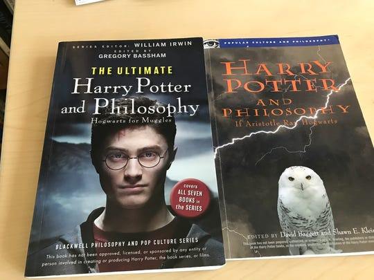 Textbooks for Professor Carolyn Hartz's philosophy course centered on the Harry Potter books rest on Hartz's desk Tuesday, Sept. 5 at the St. Cloud State University campus.