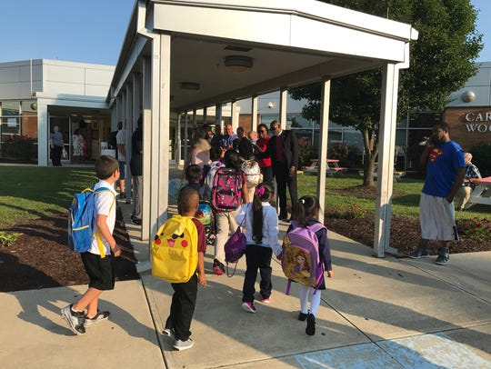Students head into Carter G. Woodson Elementary School,