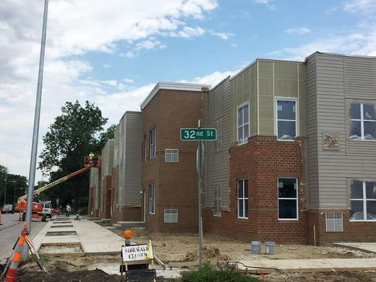 The Forest Avenue Urban Renewal Area between 32nd and 33rd streets received tax increment financing from the city to redevelop a blighted area for apartments to be completed this summer.