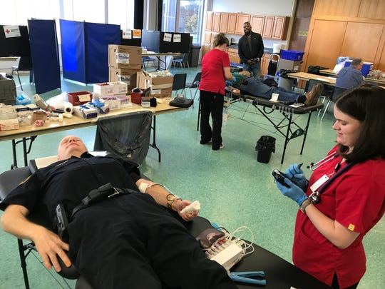 American Red Cross phlebotomist Heidi Michael watches