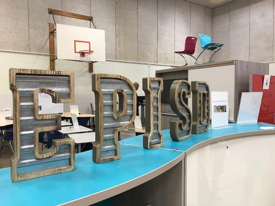 A furniture vendor displays EPISD's letters on Wednesday