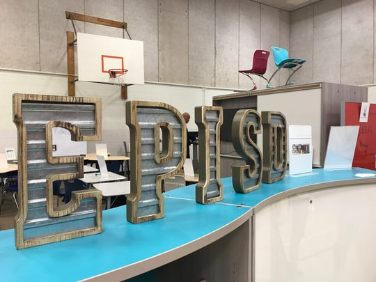 A furniture vendor displays EPISD's letters on Wednesday at Burges High School.