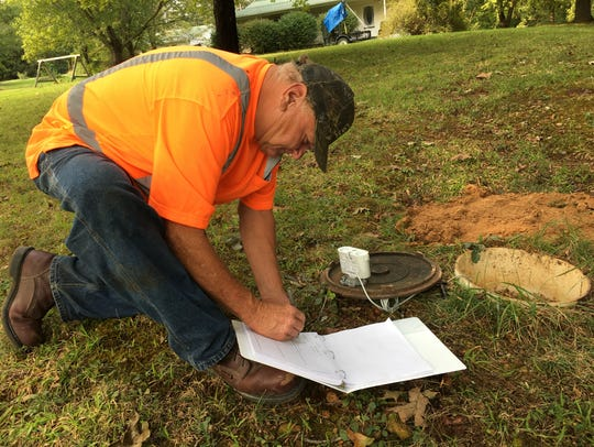 Jerry Smith records the new electronic meter number