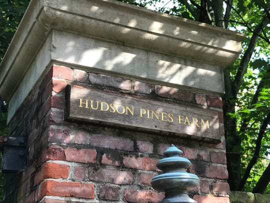 The gate of Hudson Pines Farm at 180 Bedford Road,