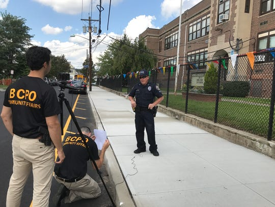 The Garfield Police Department helps film a pedestrian