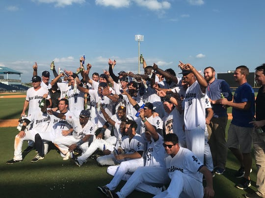 The Pensacola Blue Wahoos celebrate after defeating the Jacksonville Jumbo Shrimp to win a share of the Southern League championship on Friday at Blue Wahoos Stadium.