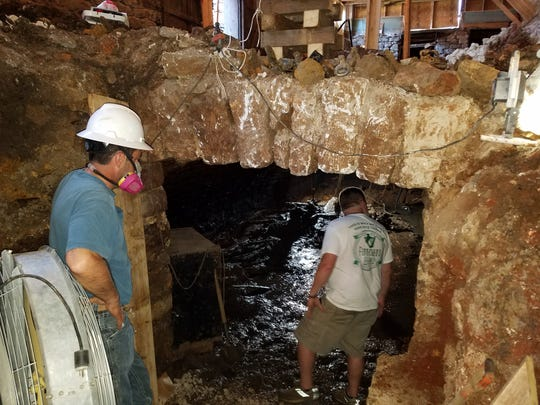 Excavation of a previously unknown vault beneath 300 E. Commercial St., the future Ophelia's wine bar, began June 22.