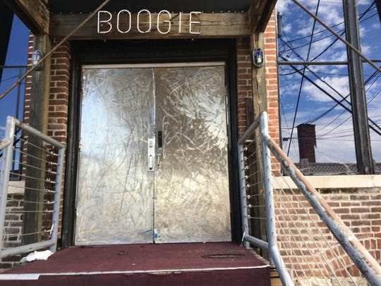 The rear entrance of The Boogie is shown Aug. 21, 2017. The space inside this door also went by the name Bubbles champagne lounge and will do so once again when the club reopens later in August of 2018.