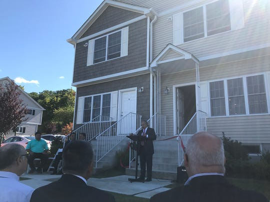 Officials and housing advocates celebrated the completion