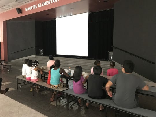 Young Hurricane Irma evacuees spent Saturday afternoon watching a movie in the Manatee Elementary School cafeteria.