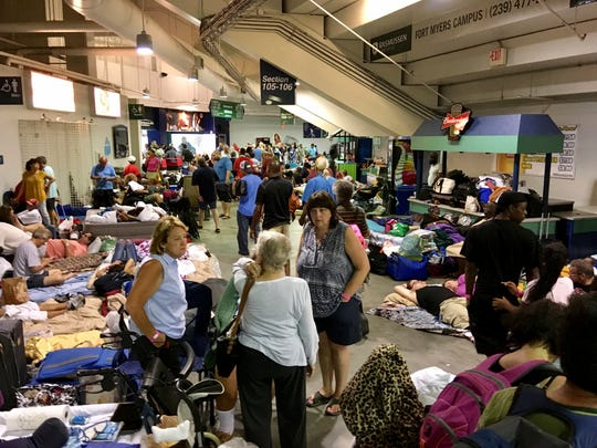 Evacuees fill Germain Arena, which is being used as a fallout shelter, in advance of Hurricane Irma, in Estero, Fla., Saturday, Sept. 9, 2017.