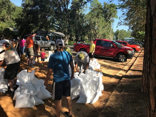 Tallahasseeans bag sand Saturday at Winthrop Park in preparation for Hurricane Irma.