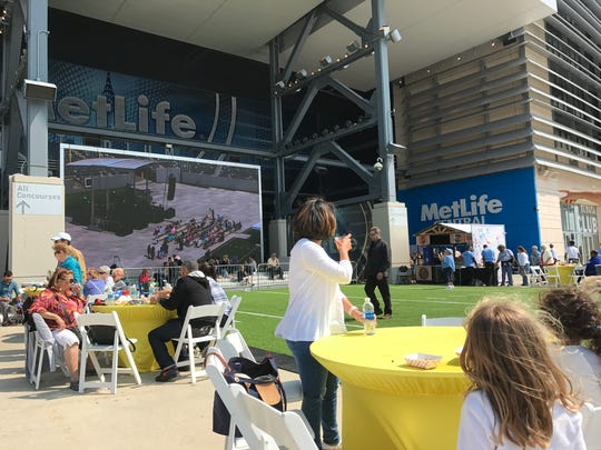 Attendees gather in the plaza at MetLife Stadium Sunday