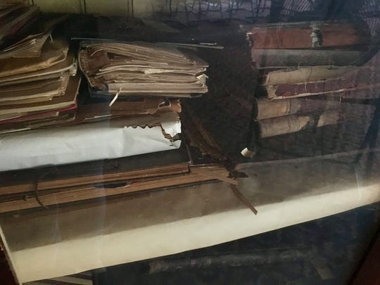 Unidentified documents in a cabinet in the Coliseum's Civil War room, which was occupied in the early 1900s by the Grand Army of the Republic, a Civil War veterans group.