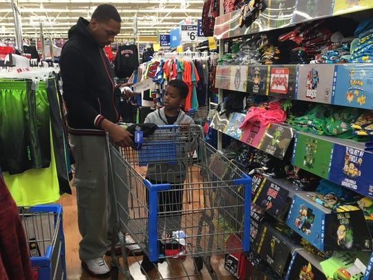 Akeen Cline Sr. and 6-year-old Akeen Cline Jr. consider