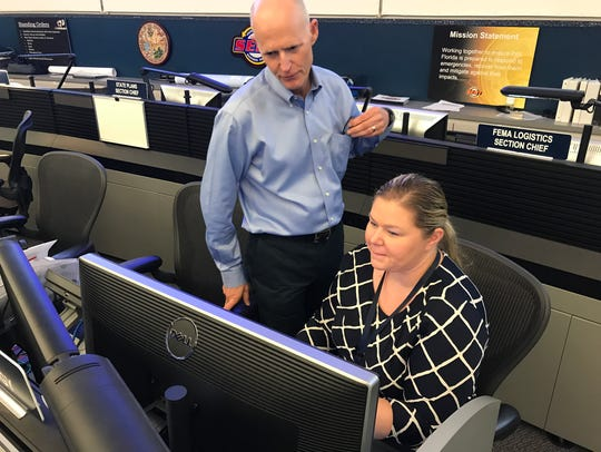 Gov. Rick Scott visits with Florida Division of Emergency