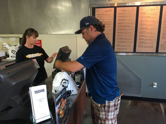 J. J. Macrae picks up an order from Fugazzi's in Visalia as part of his Mr. Takeout business.