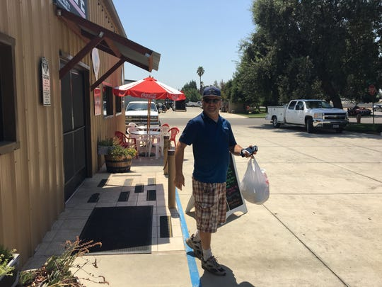 J.J. Macrae picks up a delivery order in Visalia as part of his Mr. Takeout business.