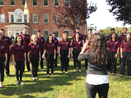 Nicole Monte directs the Nutley High School Chamber Singers during the township's 9/11 ceremony on Sept. 11, 2017.
