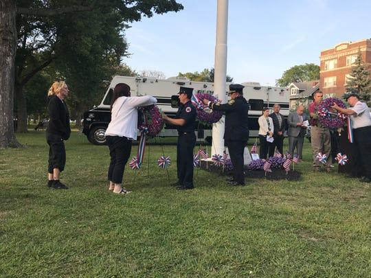 Bloomfield resident Christine Jinesta lays a wreath