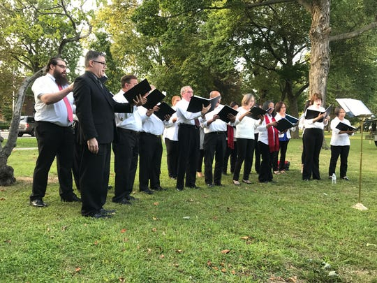 Members of the Combined Choir of Sacred Heart Church in Bloomfield sing during a 9/11 remembrance on the Town Green on Monday, Sept. 11, 2017.