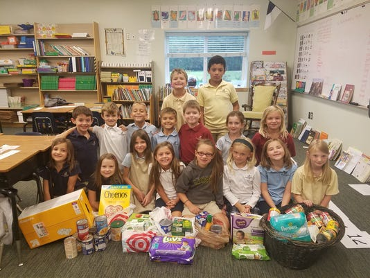 BMN 092117 Students donate