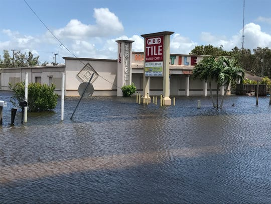Flooded business district in south Lee County between