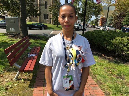 During Monday's 9/11 ceremony in Perth Amboy, Lynette Rivera wore a shirt adorned with photos, ribbons and pins in remembrance of her father Isaias Rivera, one of two Perth Amboy residents killed  in the terror attacks.