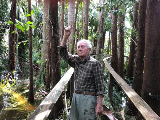 Win Turner, of the Bayshore area of East Naples, points to damage in his long-nutured botanical garden.