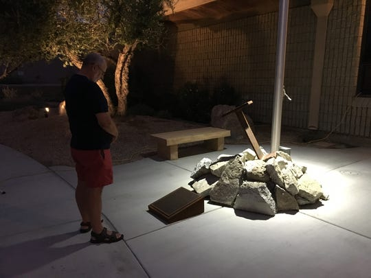 Palm Springs resident Richard Fluechtling observes the 9/11 memorial at the Palm Springs fire station on El Cielo Road. A remembrance ceremony was held on the 16th anniversary of the Sept. 11 terrorist attacks.