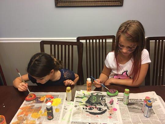 After they finished painting their faces, Ella Buss,