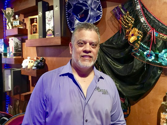 Sergio Romero owns Tequila Azul in Viera with his son,