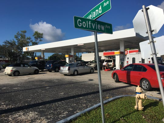 Lines of cars 20 deep wait to fill up with gas at the Shell station/Circle K at the corner of Golfview Drive and U.S. 41 in Fort Myers this morning.