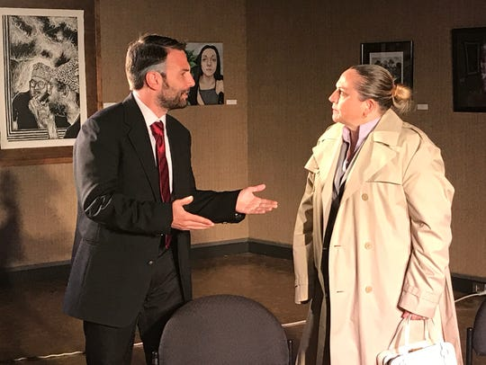 Alan, portrayed by Todd Isaac, left, argues with his