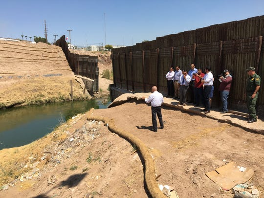 Local and state officials visit the New River at the U.S.-Mexico border in Calexico on June 30, 2017.