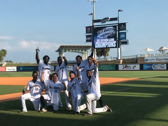 Members of the Blue Wahoos celebrate their Southern
