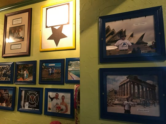 In keeping with its vacation theme, the Highland House offers wall space and gift cards to those who take pictures in Highland House T-shirts on their own vacations.