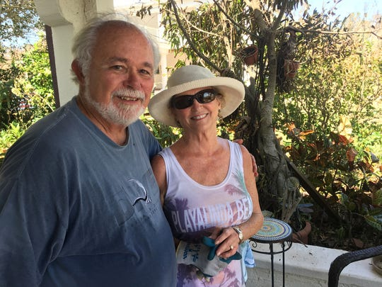 Barbara and Hank Evans at their Titusville home, taking a break from Hurricane Irma clean-up.