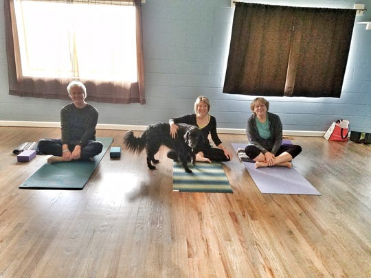 Bev Palmer, right, teaches the first yoga class at Jack's Mountain Preserve on Sept. 11.