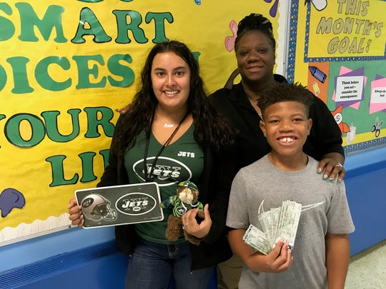 Elizabeth James, coordinator of the Upstander of the Week program at Soehl Middle School in Linden, with the first two winners, Jessica Rengifo and Jimmie Jones. Selected students win three tickets to a Jets game.