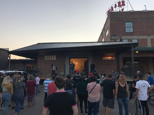Walter Portz and Jeff Zueger, co-founders of the Sioux Falls Downtown Skatepark Association, speak to a group of supporters Wednesday night at 8th & Railroad.