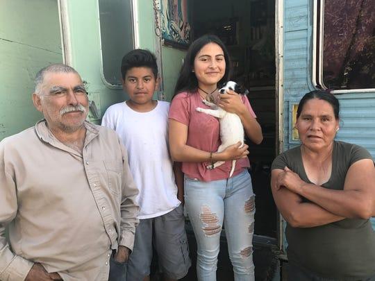 Left, Manuel Orozco Rodriguez, son Eduardo, 11, daughter Mayra, 16 and wife Hortensia Escalante stand in front of their trailer.