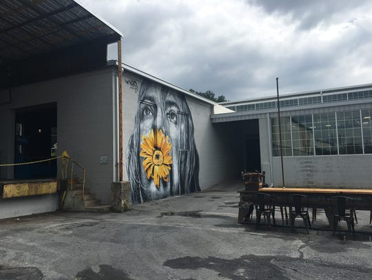 Mural work by NilsWestergard at Basic City Beer Company