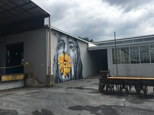 Mural work by Nils Westergard at Basic City Beer Company in Waynesboro. The mural work was done during the 3rd annual Virginia Street Arts Festival on Sept. 9, 2017.