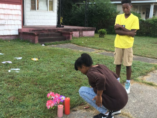 Tonesha Bullard, left, and Cassie Bullard place flowers