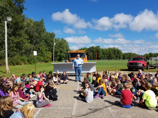Mayor Mike Wiza talks to students Sept. 8 at Madison Elementary School in Stevens Point about the Paint the Plow project.